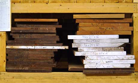 Planks of South American Mahogany on rack